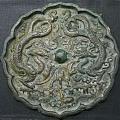 自藏多年的两面金代铜镜